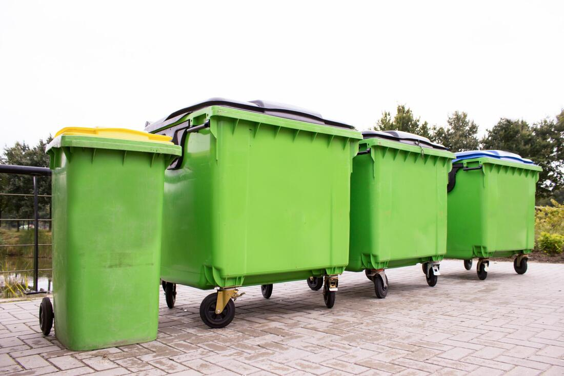 a four green dumpster